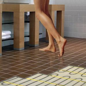 Heated Floors | Midwest Direct Flooring on towel warmer in bathroom, glass block window in bathroom, radiant heat in bathroom, jacuzzi tub in bathroom, marble in bathroom, mirror in bathroom, walk-in closet in bathroom, hair dryer in bathroom, lighting in bathroom, gas fireplace in bathroom, sauna in bathroom, granite in bathroom, skylights in bathroom,